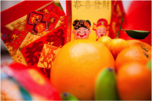Chinese New year traditions. Give a red envelope
